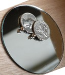 Two Bicentennial Quarters and Two Ball Bearings on a Mirror (Reflection)